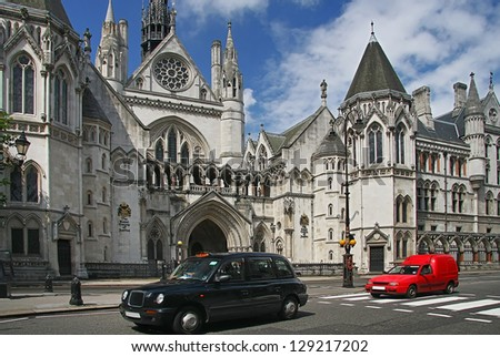 LONDON - JULY 20, 2012: Royal courts of justice in London, commonly called the Law Courts, was built in the 1870 and were opened by Queen Victoria in December 1882. London, July 20, 2012. - stock photo