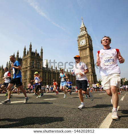 LONDON - JULY 14 : Runners in UK 10km fun Marathon on July 14, 2013 in London, UK. The British 10k London Marathon, 13th year, about 25,000 runners from all over the world joined. - stock photo