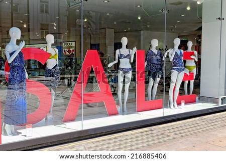 LONDON - JULY 1, 2014. Seasonal sale now on in Debenhams department store, Oxford street, London. A lot on goods are sold at 50% reduced price at the and of each season.  - stock photo