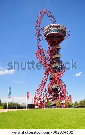 LONDON - JULY 3, 2014. The ArcelorMittal Orbit sculpture at the Queen Elizabeth Olympic Park, a legacy of the Olympic Games designed by Anish Kapoor and Cecil Balmond, at Stratford, London, UK. - stock photo