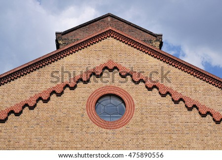LONDON - JULY 23, 2016. The finely detailed brick facade of the 1865 German Gymnasium, now restored and converted to a restaurant and bar near King's Cross St Pancras raillway station, London.