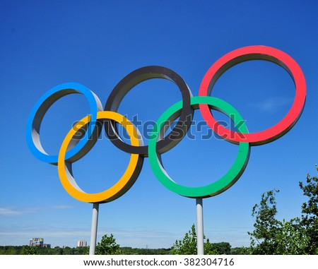 LONDON - JULY 3, 2014. The Olympic Games symbol in the new Queen Elizabeth Olympic Park; a legacy of the games at Stratford, east London, UK.