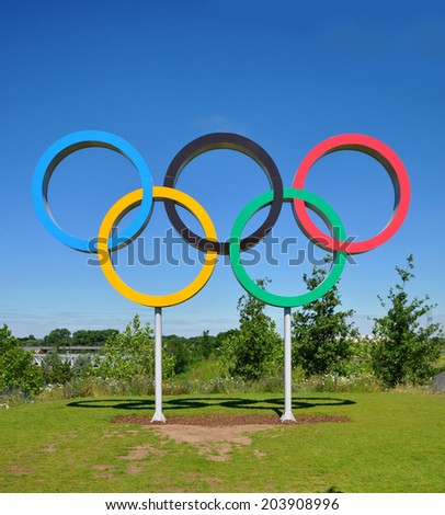 LONDON - JULY 3. The Olympic Games symbol in the new Queen Elizabeth Olympic Park, on July 3, 2014, a legacy from the games in the large well landscaped recreation area at Stratford, east London. - stock photo