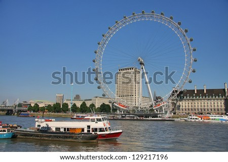 LONDON - JULY 26, 2012: View of The London Eye on July 26, 2012 in London, England. A famous tourist attraction over river Thames in the capital city London. July 26, 2012. - stock photo