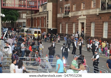 LONDON - JULY 23: Well wishers wait to see the new royal baby outside St Mary's Hospital in Paddington, London July 23rd, 2013 in London England. - stock photo