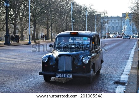 LONDON - JUNE 26 : A London Taxi or 'Black Cab' on June 26, 2014 in London, UK. All London cabs undergo a strict annual mechanical test before they are allowed to ply for hire.