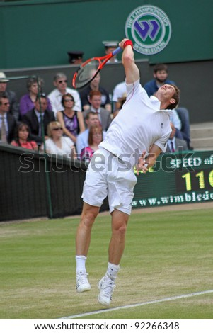 LONDON - JUNE 24: Andy Murray of Scotland returns ball during second round match against Jarkko Nieminen of Finland at Wimbledon in London, England on June 24, 2010 - stock photo