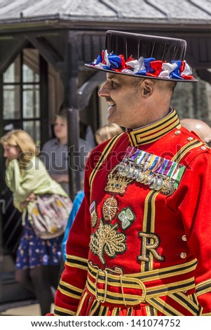 LONDON - JUNE 03: Beefeaters (Yeomen Warders of Fortress Tower of London) in Tudor State Dress on occasion of celebrating 60 anniversary of Coronation of Queen Elizabeth II, on June 03, 2013 in London - stock photo