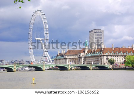 LONDON - JUNE 04: Close up view of London Eye,which is the tallest ferris wheel in Europe, along the bank of the Thames River on June 04, 2012 in London. - stock photo