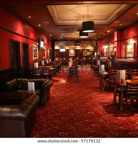 LONDON - JUNE 3: Interior of pub, for drinking and socializing, focal point of the community, on June 3, 2011, London, UK. Pub business, now about 53,500 pubs in the UK, has been declining every year - stock photo