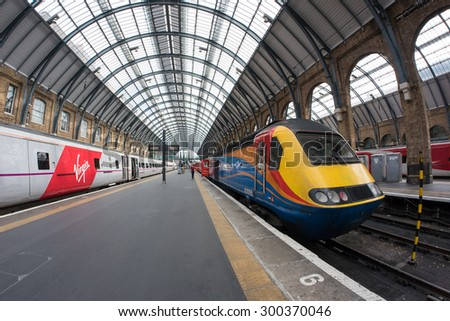 LONDON - JUNE 17, 2015: Interior view of King's Cross railway station, a major London railway terminus which opened in 1852 on the northern edge of central London. - stock photo