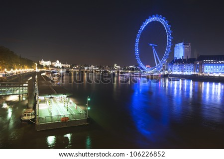 LONDON - JUNE 10: London Eye with Big Ben, on June 10, 2012 in London. The largest Ferris wheel in Europe, structure of the London Eye is 135 meters tall and the wheel has a diameter of 120 meters - stock photo