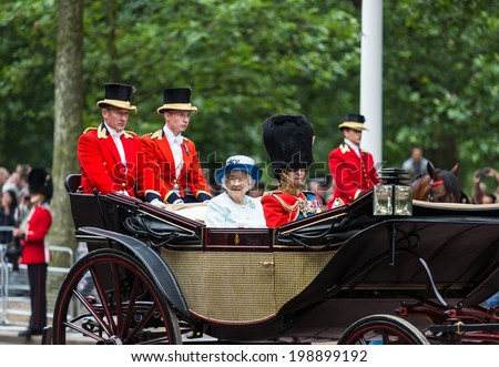 LONDON - JUNE 14: Queen Elizabeth II and Prince Philip seat on the Royal Coach at Queen's Birthday Parade, also known as Trooping the Colour, on June 14, 2014 in London, England. - stock photo