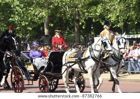 LONDON - JUNE 17: Queen Elizabeth II and Prince Philip seat on the Royal Coach at Queen's Birthday Parade on June 17, 2006 in London, England. - stock photo