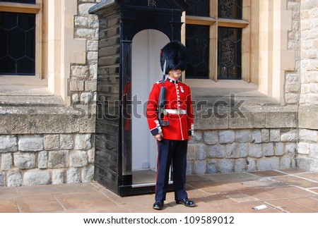 LONDON - JUNE 02:Queen's Guard - Tower of London on June 02 2012. The Queen's Guard is the contingents of infantry and cavalry soldiers charged with guarding the official royal residences. - stock photo