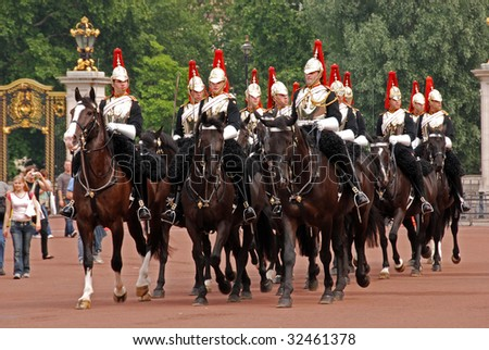 LONDON - JUNE 9 Royal Guards on parade in front of Buckingham Palace on June 9, 2007 in London, UK - stock photo