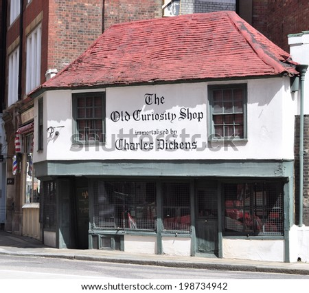 LONDON - JUNE 8. The Old Curiosity Shop on June 8, 2014, built in 1567, probably the oldest shop in the city, immortalised by Charles Dickens and now a shoe shop in historic Aldwych, London. - stock photo