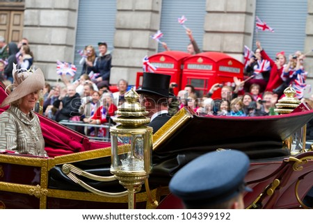 LONDON - JUNE 5: The Queen's carriage procession carrying Prince of Wales and the Duchess of Cornwall makes its way to Buckingham Palace during Diamond Jubilee celebrations on June 5, 2012 in London. - stock photo