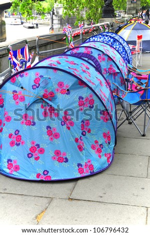 LONDON - JUNE 01: Unidentified people sleep in a tent alongside the River Thames to witness Thames Diamond Jubilee boats parade on June 1, 2012 in London.