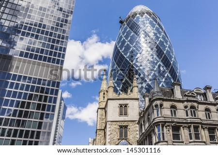 LONDON - JUNE 3: View of Gherkin building (or 30 St Mary Axe, 2004) in London on June 3, 2013. Gherkin - iconic symbol of London, one of city's most widely recognized examples of modern architecture. - stock photo