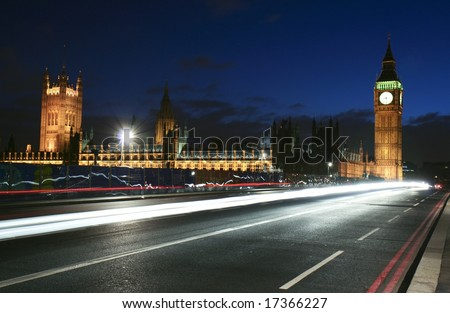 London landmark- Big Ben and House of Parliament with street traffic in the foreground - stock photo