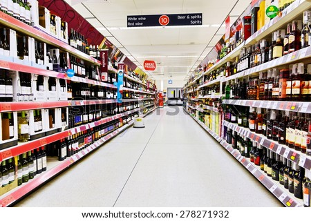 LONDON - MAR 7: A general view of an empty aisle at a Sainsbury's supermarket on Mar 7, 2015 in London, UK. Sainsbury's is the UK's second largest supermarket with a revenue of £23 bln in 2013. - stock photo