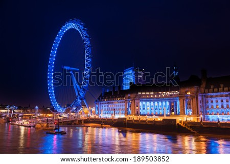 LONDON - MAR 30: London Eye at night with river Thames on Mar 30, 2014 in London, UK. At a height of 135 meters, London Eye is the tallest Ferris wheel in Europe.