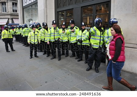 LONDON - MAR 26: Riot police deploy in the city center after violent riots break out during a 250,000 strong TUC organised anti public sector spending cuts rally on Mar 26, 2011 in London, UK.