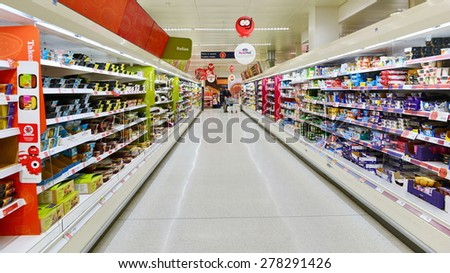 LONDON - MAR 7: View of an empty aisle at a Sainsbury's supermarket on Mar 7, 2015 in London, UK. Sainsbury's is the UK's second largest supermarket retailer with a revenue of £23 billion in 2013.
