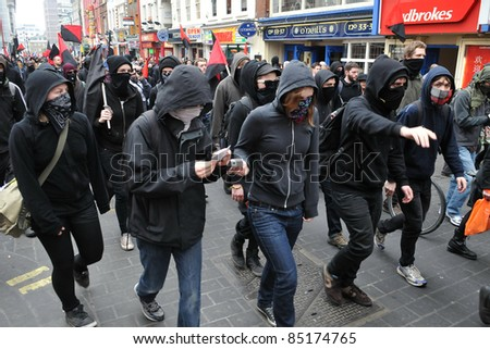 LONDON - MARCH 26: A breakaway group of protesters march through the streets of the British capital during a large anti-cuts rally 26 March 2011 in London, UK.