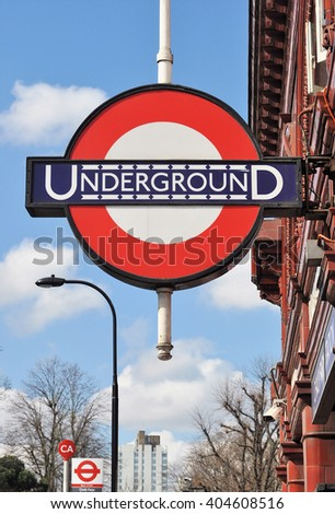 LONDON - MARCH 31, 2016. An early 20th century version of the underground railway logo still in use at the entrance to Chalk Farm station on the Northern Line in the Borough of Camden, London.