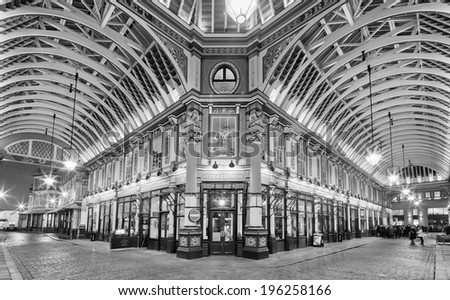 LONDON - MARCH 8: Night shot of bankers drinking beer after work in the covered Leadenhall Market, one of the tourist attractions in London. London, UK, March 8, 2013. - stock photo