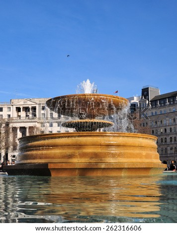 LONDON - MARCH 6, 2015. One of the fountains in Trafalgar Square, a popular tourist venue with the National Gallery on the north side and Nelson's Column to the south in central London, UK. - stock photo