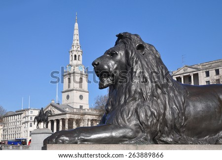 LONDON - MARCH 6, 2015. One of the four lion scultures designed by the artist Sir Edwin Landseer emplaced at the foot of Nelson's Column in 1867 in Trafalgar Square, London, UK. - stock photo