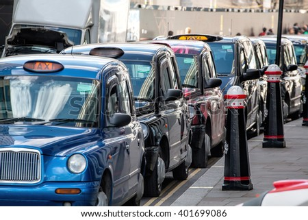 LONDON - MARCH 31, 2016: Row Of London Licensed Black Taxi Cabs Waiting For Fares. - stock photo