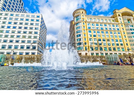 LONDON - MARCH 20: The Canary Wharf district pictured on March 20th, 2015, in London. Canary Wharf is the main Financial District of London. It is one of the UK's two main financial centres.  - stock photo