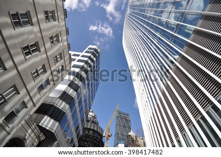 LONDON - MARCH 25, 2016.  The commercial skyscraper, 20 Fenchurch Street, designed by Rafael Vinoly, informally known the Walkie Talkie and surrounding buildings in the financial district of London. - stock photo