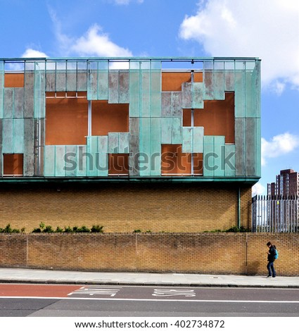 LONDON - MARCH 31, 2016. The oxidized copper clad Haverstock School; a comprehensive school designed by Feilden Clegg Bradley Architects for 1225 students aged 11 to 18 at Camden, north London. - stock photo