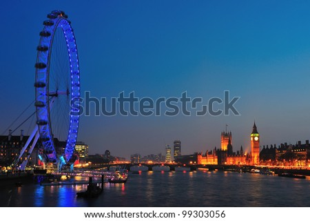 LONDON - MARCH 25 : View of The London Eye and House of Parliament on March 25, 2012 in London, England. A famous tourist attraction over river Thames with more than 3 million visitors a year. - stock photo