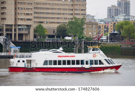 LONDON-MAY 21: A City Cruises tour boat sails on the Thames River on May 21, 2013 in London, England. Thames is the longest river in England with 346 km (215 miles) long. - stock photo