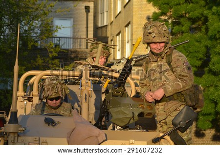 LONDON - MAY 14 2015:British Army soldiers.According to Ministry of Defence, it costs £30,000 to train a soldier.Selection costs £7,000, while Basic Training and Combat Infantry Course cost �£23,000 - stock photo