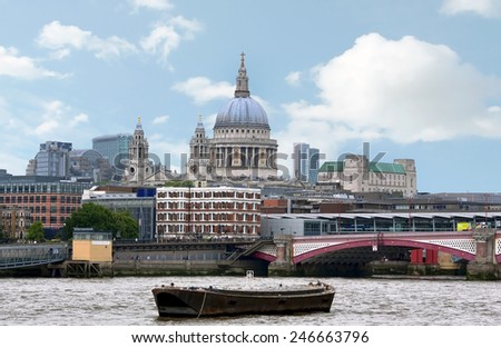 LONDON - MAY 15: City of London view from the London bridge. St. Paul cathedral in London on May 15.2014 in England