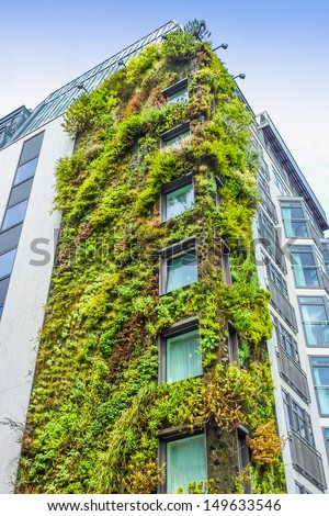 LONDON - MAY 14: Ecologic building with plants on the external part on May 14, 2011 in London, UK. The capital of UK is famous for its ecological development with many projects for the environment. - stock photo
