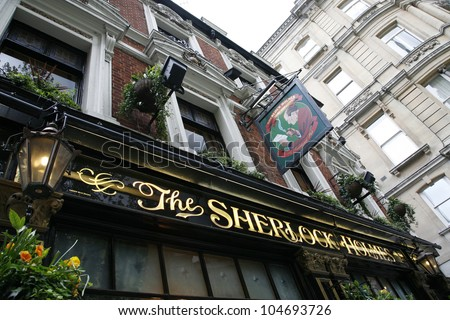LONDON - MAY 6: Exterior of pub, for drinking and socializing, focal point of community, on May 6, 2012, London, UK. Pub business, now about 53,500 pubs in the UK, has been declining every year - stock photo