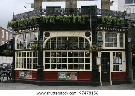 LONDON - MAY 8: Exterior of pub, for drinking and socializing, focal point of the community, on May 8, 2010, London, UK. Pub business, now about 53,500 pubs in the UK, has been declining every year - stock photo