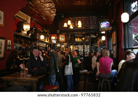 LONDON - MAY 7: Inside view of pub, for drinking and socializing, focal point of the community, on May 7, 2006, London, UK. Pub business, now about 53,500 pubs in the UK, has been declining every year - stock photo