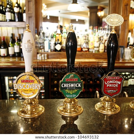 LONDON - MAY 12: Interior of pub, for drinking and socializing, focal point of community, on May 12, 2012, London, UK. Pub business, now about 53,500 pubs in the UK, has been declining every year - stock photo