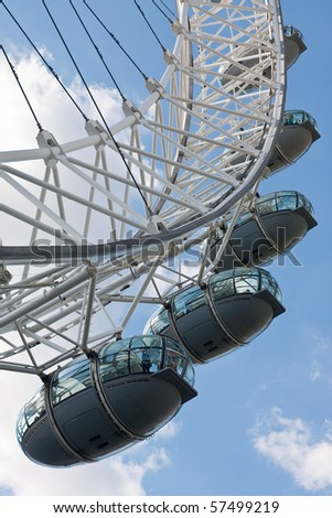 LONDON - MAY 31: London Eye (aka Millennium Wheel) is the leading paid tourist attraction in the United Kingdom May 31, 2009 in London, England - stock photo