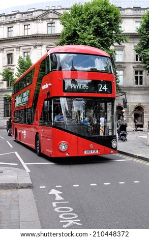 LONDON - MAY 3. London's Routemaster diesel-electric hybrid double deck bus with three doorways and two staircases accommodates 80 passengers; May 3, 2014, in St Martins Place, London, UK.  - stock photo