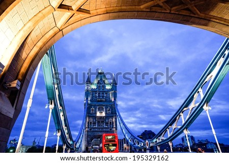 LONDON - MAY 26 : London Tower Bridge pictured at night on May 26th, 2014, in London, UK. Built in 1886, it is a combined bascule and suspension bridge in London over the River Thames. - stock photo